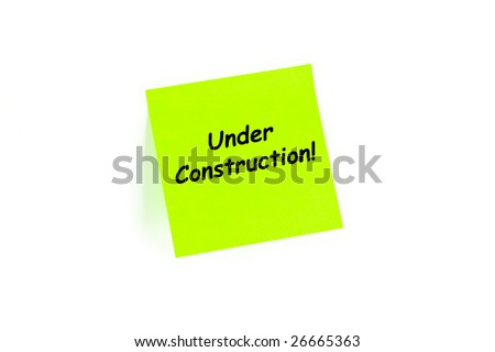 "The phrase ""Under Construction!"" on a post-it note isolated in white"
