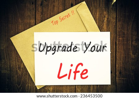 The phrase Upgrade Your Life typed on a piece of paper