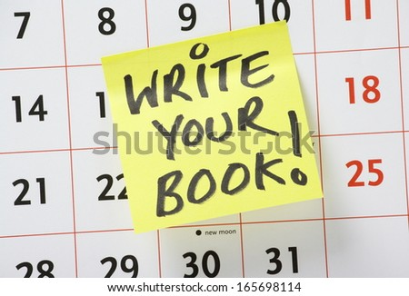 The phrase Write Your Book written on a yellow sticky paper note and stuck to a wall calendar as a reminder to get on with the work of starting your novel or other written work. - stock photo