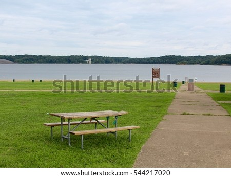 The picnic table by the lake.