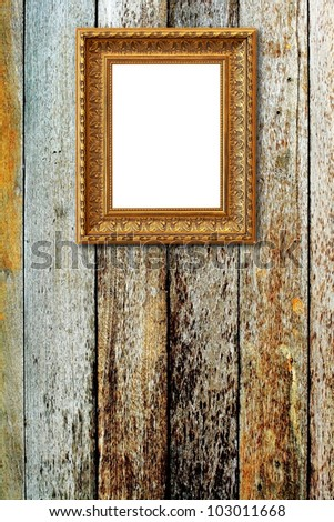 The picture frame on wood background - stock photo