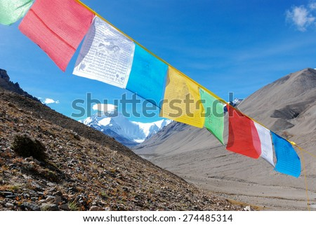 The picture was taken from the slope above the Rongbuk Monastery at 4980 meters above sea level, the highest monastery of the world./Tibet, prayer flags, the Mt. Everest (8848 m) in the background - stock photo