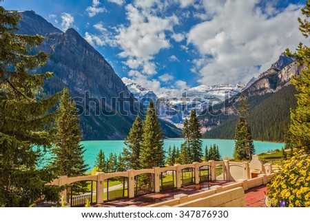 The picturesque embankment at Lake Louise. The lake is surrounded by mountains, glaciers and pine forests. Banff National Park, Rocky Mountains, Canada - stock photo