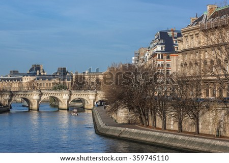 The picturesque embankment of the Seine River on the Sunset. Paris, France. - stock photo