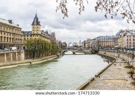 The picturesque embankments of the Seine in Paris, France. Buildings and trees. - stock photo