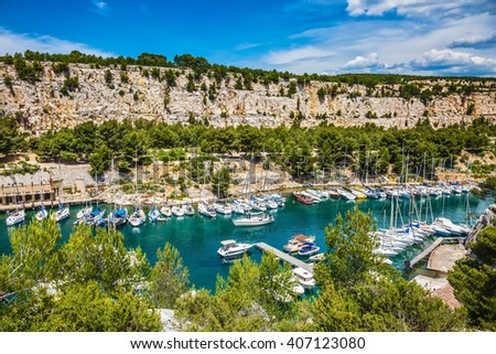 The picturesque fjord with turquoise water at coast of the Mediterranean Sea. National park of Calanques in Provence, between Marseille and Kassis.  Graceful sailing yachts in the deep sea gulf - stock photo