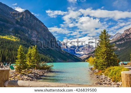 The picturesque promenade at Lake Louise. The lake is surrounded by mountains, glaciers and pine forests. Banff National Park, Rocky Mountains, Canada - stock photo