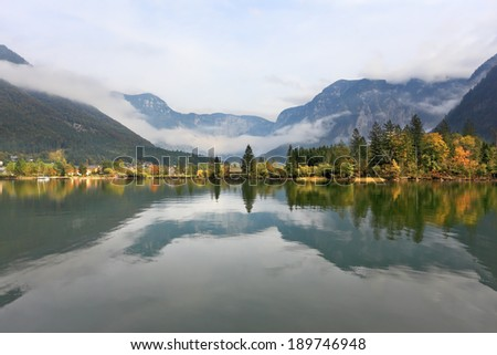 The picturesque shores of Lake Hallstatt. Mountains reflected in the smooth water of the lake