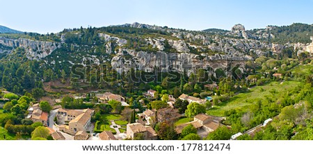 The picturesque view on Alpilles and Fontaine Valley from the rocky spur of Les Baux-de-Provence village, France. - stock photo