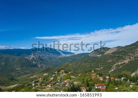 The picturesque village stretches in the valley among Parnassus mountains, Greece.