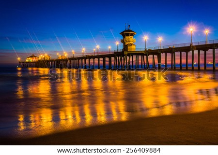 The pier at night, in Huntington Beach, California. - stock photo