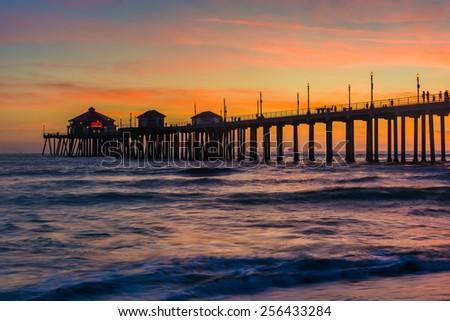 The pier at sunset, in Huntington Beach, California. - stock photo