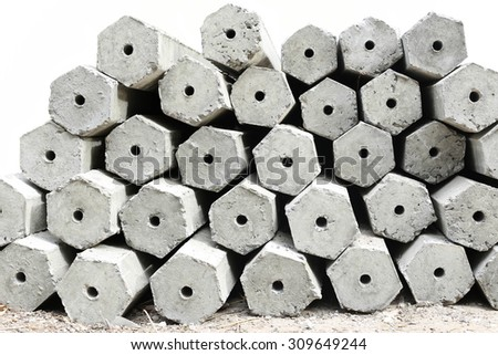 The pile of hexagon concrete foundation piles isolated in white background - stock photo