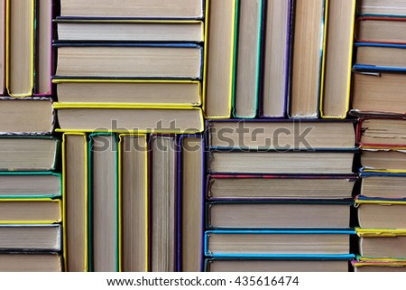 The piles of books on the shelf closeup. Library. Back to school. The background of the books. - stock photo