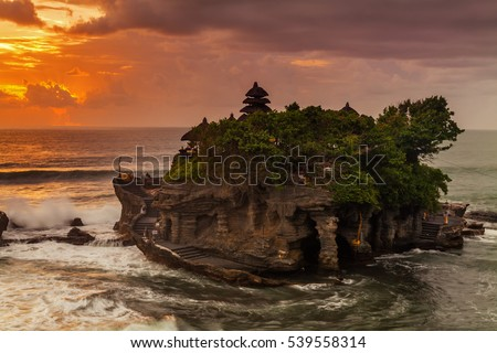 The Pilgrimage Temple of Pura Tanah Lot is perched dramatically on a large coastal rock.