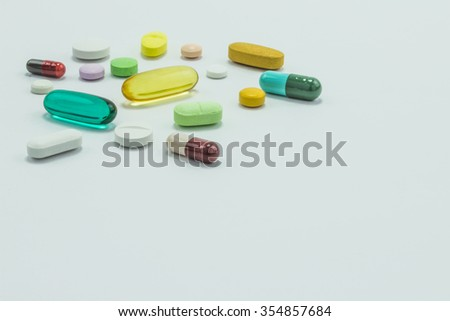 The pill capsules on the white background - stock photo