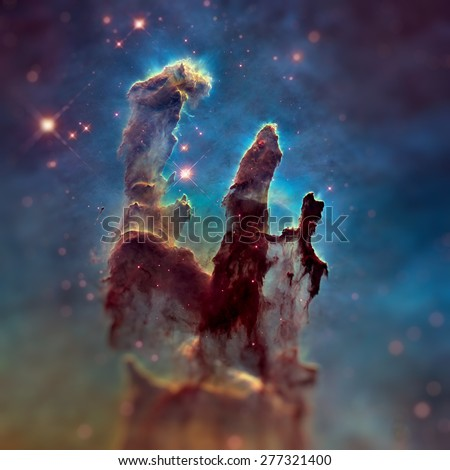 The Pillars of Creation. The Eagle Nebula (M16, NGC 6611) is a young open cluster of stars in the constellation Serpens. Retouched image with small DOF. Elements of this image furnished by NASA. - stock photo