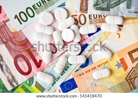 the pills and euro banknotes - stock photo