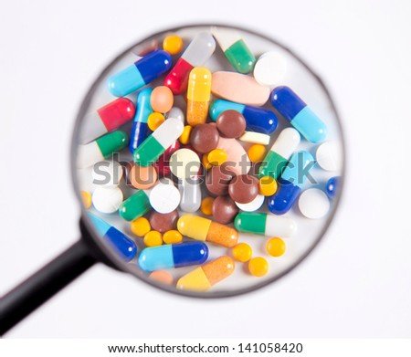 The pills under scrutiny - stock photo