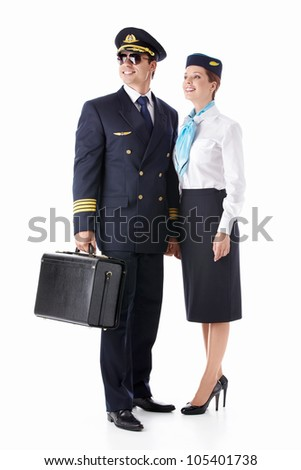The pilot and flight attendant with a suitcase isolated - stock photo