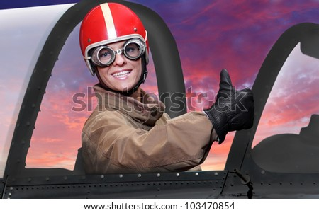 The pilot in cockpit of a vintage plane. Close up with shallow DOF. - stock photo