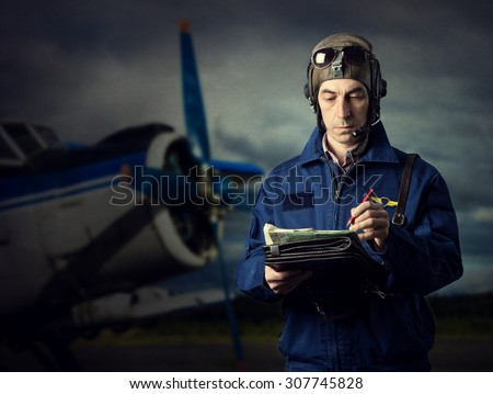 The pilot of the plane on the background. - stock photo