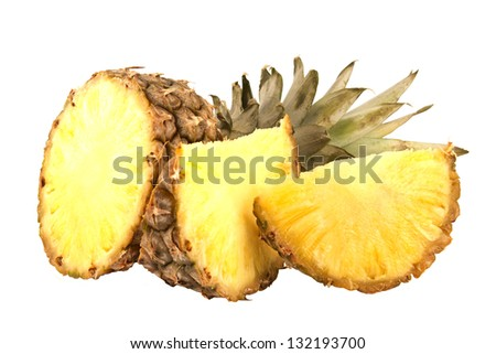 The pineapple fruit sliced at the white background