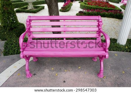 The pink chair in a park.