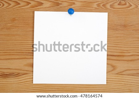The pink square blank sheet pinned on a board from a tree