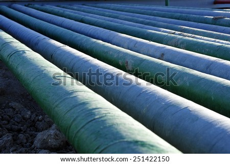 The pipe and valve oil fields - stock photo