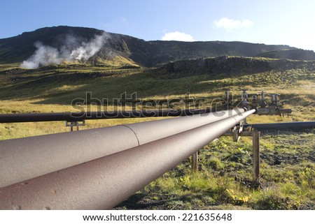 The pipe system supplying geothermal energy in Iceland - stock photo
