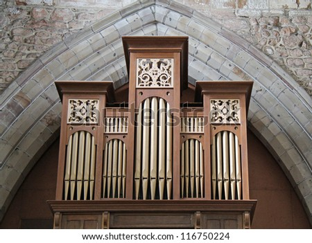 The Pipes of a Traditional Church Music Organ. - stock photo