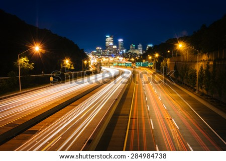 The Pittsburgh skyline and I-279 at night, in Pittsburgh, Pennsylvania. - stock photo