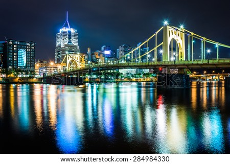 The Pittsburgh skyline and Roberto Clemente Bridge at night, seen from the North Shore in Pittsburgh, Pennsylvania. - stock photo