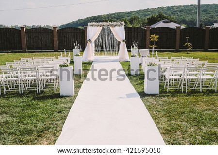 the place of the wedding ceremony. decor, chairs and an arch of flowers.