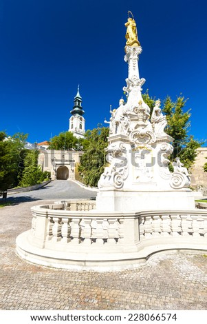 the plague column and castle in Nitra, Slovakia - stock photo