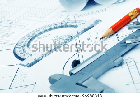 The plan industrial details, a protractor, caliper and a red pencil. A photo closeup. Blue toning - stock photo