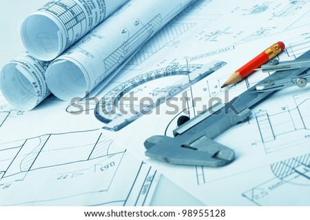 The plan industrial details, a ruler, caliper, divider and a red pencil. A photo closeup. Blue toning