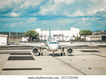 The plane at the airport on loading - stock photo
