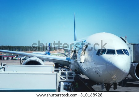 The plane at the airport on loading. - stock photo