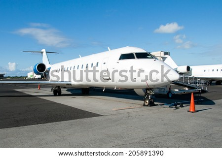 The plane at the airport ready for boarding - stock photo