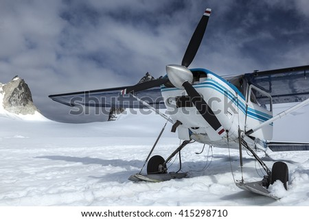 The plane has landed on a glacier in mountains of Alaska, the USA