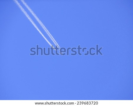 The plane in the blue sky. Russian aviation. - stock photo