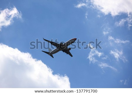 The plane in the sky - stock photo
