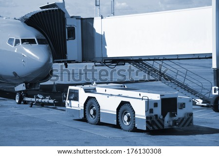 The plane is waiting boarding of passengers at airport  - stock photo
