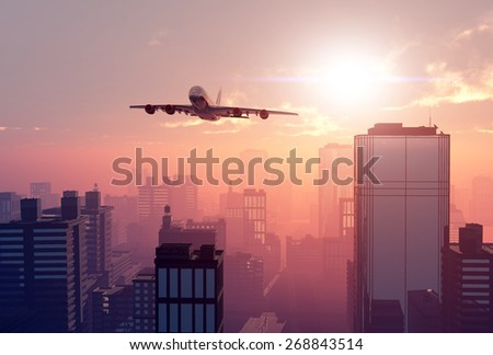 The plane on a background a city - stock photo