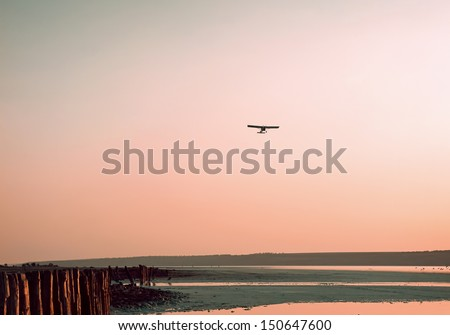 The plane on a background of the sky - stock photo