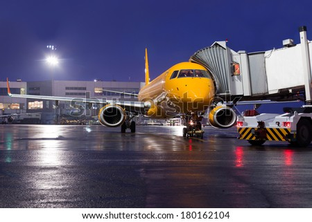 the plane on airport parking at night waiting for passengers - stock photo