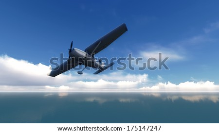 The plane was flying over the sea on blue sky