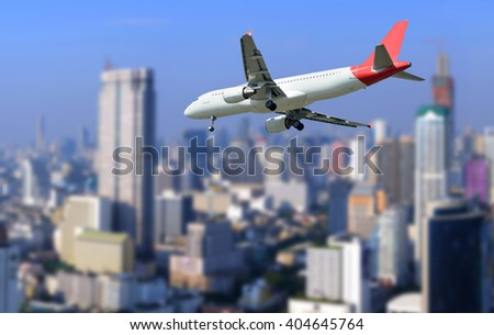 The plane was landing on city background.